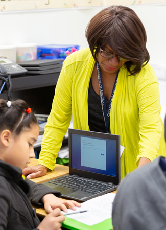 Photo: Teacher showing student on paper