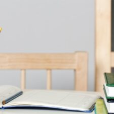 Photo: Pencils with an apple on teacher's desk