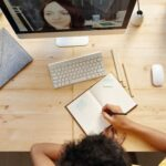 Photo: Writing while looking at computer